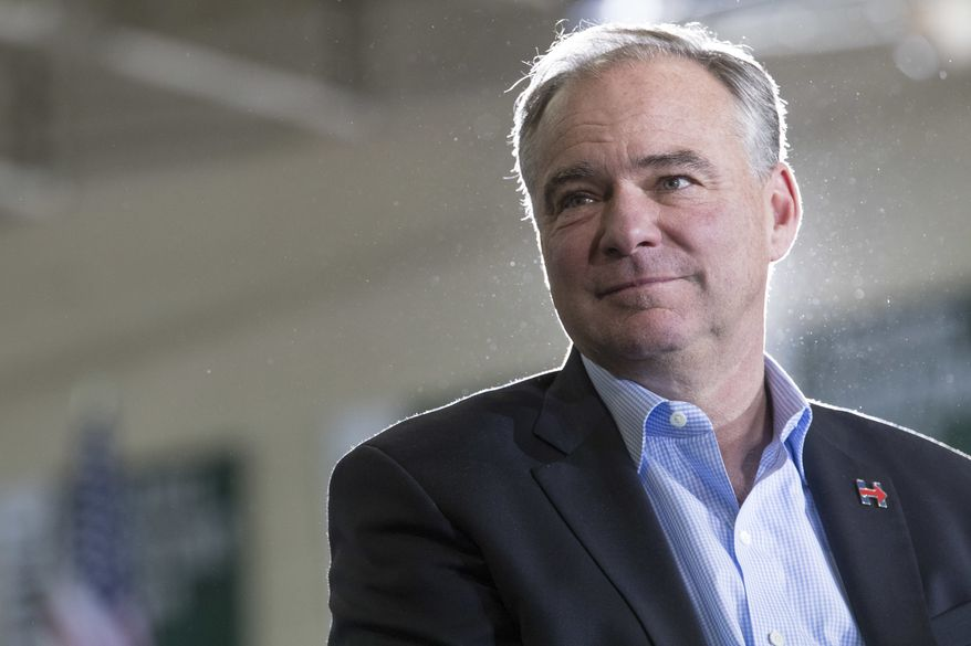 Then-Democratic vice presidential candidate Sen. Tim Kaine, D-Va., listens as Democratic presidential candidate Hillary Clinton speaks during a campaign event at the Taylor Allderdice High School, Saturday, Oct. 22, 2016, in Pittsburgh, Pa. (AP Photo/Mary Altaffer) ** FILE **