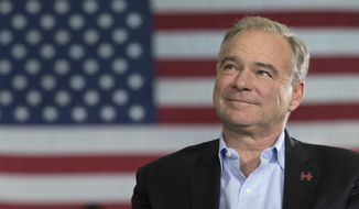 Democratic vice presidential candidate Sen. Tim Kaine, D-Va., listens as Democratic presidential candidate Hillary Clinton speaks during a campaign event at the Taylor Allderdice High School, Saturday, Oct. 22, 2016, in Pittsburgh, Pa. (AP Photo/Mary Altaffer) ** FILE **