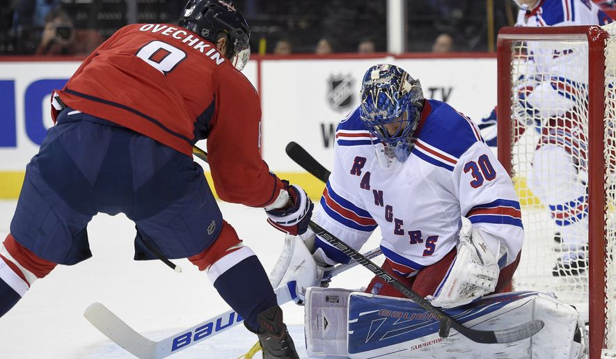 New York Rangers goalie Henrik Lundqvist (30), of Sweden, stops Washington Capitals left wing Alex Ovechkin (8), of Russia, during the second period of an NHL hockey game, Saturday, Oct. 22, 2016, in Washington. (AP Photo/Nick Wass)