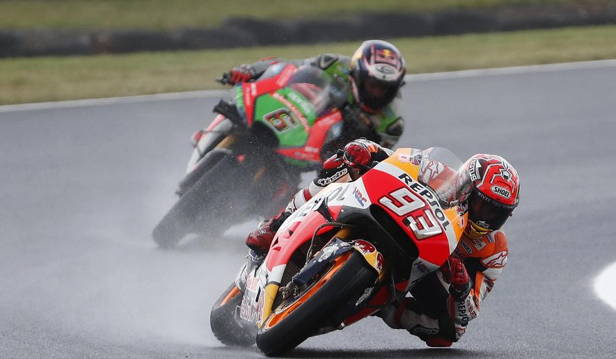 Honda MotoGP rider Marc Marquez of Spain leads Aprilia Racing Team Gresini MotoGP rider Stefan Bradl of Germany during the qualifying session for the Australian Motorcycle Grand Prix in Phillip Island, Australia, Saturday, Oct. 22, 2016. (AP Photo/Glenn Nicholls)