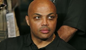 "ADVANCE FOR WEEKEND EDITIONS, OCT 22-23 - FILE - In this May 2, 2015, file photo, Charles Barkley joins the crowd before the start of the world welterweight championship bout between Floyd Mayweather Jr., and Manny Pacquiao in Las Vegas. Barkley calls it friendly fire, the criticism a rich black gets for talking about race from fellow blacks who believe he can't understand their struggles. But the basketball Hall of Famer and TNT analyst says he can handle it, and hopes he can create conversation that makes a difference beyond the things he's already doing when his show ""The Race Card"" debuts in 2017.  (AP Photo/John Locher, File)"