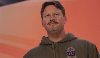 New York Giants head coach Ben McAdoo stands on stage during an NFL Fan Rally at the NFL House in Victoria House, in London, Saturday Oct. 22, 2016. The Los Angeles Rams are due to play the New York Giants at Twickenham stadium in London on Sunday in a regular season NFL game. (AP Photo/Tim Ireland)
