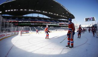 Edmonton Oilers' Connor McDavid (97) watches over his team during practice at Investors Group Field for the NHL Heritage Classic outdoor hockey game in Winnipeg, Manitoba, Saturday, Oct. 22, 2016. The Oilers taken on the Winnipeg Jets Sunday. (John Woods/The Canadian Press via AP)