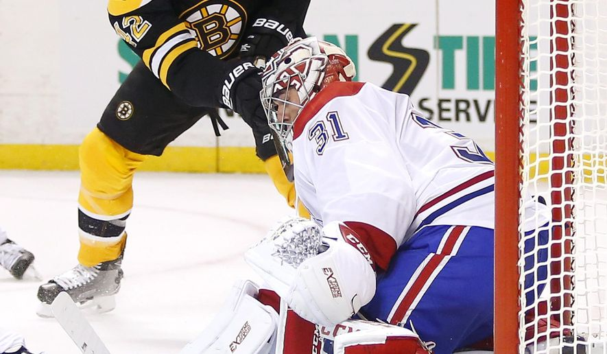 Montreal Canadiens goalie Carey Price stops Boston Bruins' David Backes during the second period of an NHL hockey game in Boston on Saturday, Oct. 22, 2016. (AP Photo/Winslow Townson)