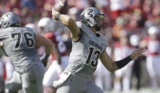 Colorado quarterback Sefo Liufau (13) passes against Stanford during the first half of an NCAA college football game, Saturday, Oct. 22, 2016, in Stanford, Calif. (AP Photo/Ben Margot)
