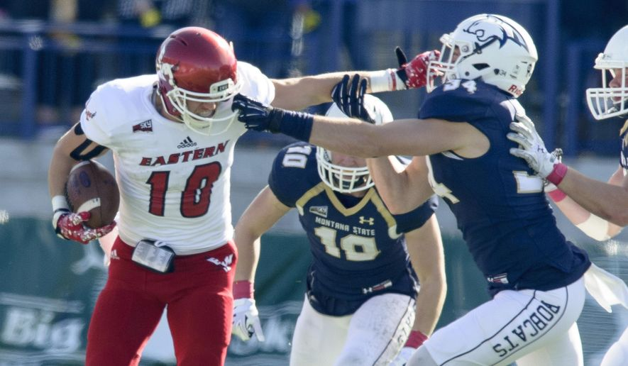 In this photo provided by Montana State University, Eastern Washington wide receiver Cooper Kupp (10) fights off Montana State defenders during the first half of an NCAA college football game against Eastern Washington Saturday, Oct. 22, 2016 in Bozeman, Mont. (Kelly Gorham/ Montana State University via AP)