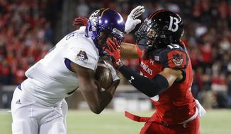 East Carolina wide receiver Zay Jones, left, runs the ball against Cincinnati cornerback Grant Coleman (13) during the first half of an NCAA college football game, Saturday, Oct. 22, 2016, in Cincinnati. (AP Photo/John Minchillo)