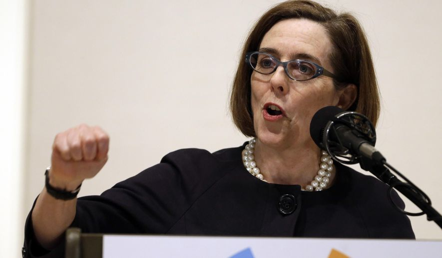 FILE- In this April 17, 2015, file photo, Oregon Gov. Kate Brown speaks during her State of the State address in Portland, Ore. Brown says she supports Oregon's contentious Ballot Measure 97 because the state budget is facing a $1.3 billion deficit, and the money is needed to help fund education, health care and senior services. (AP Photo/Don Ryan, File)