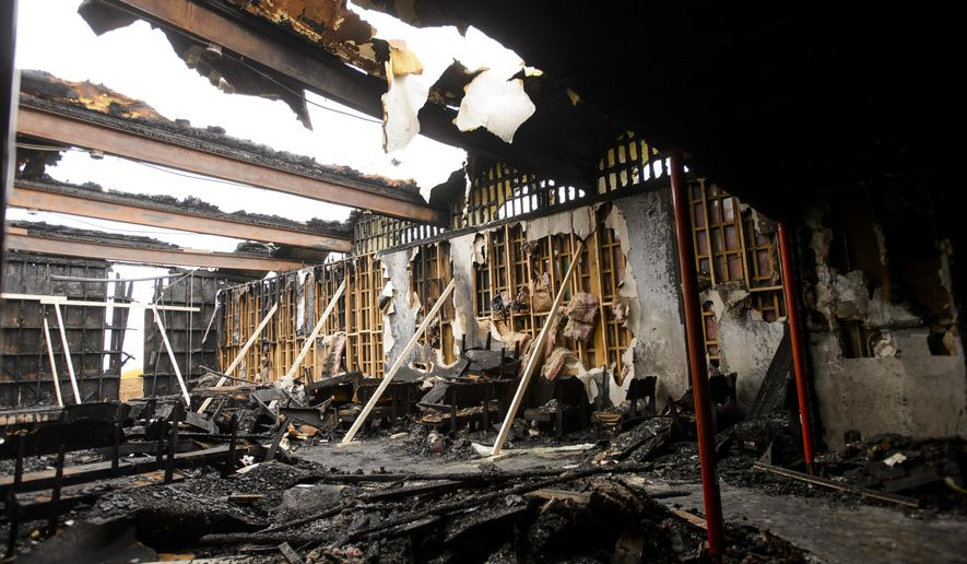 ADVANCE FOR SATURDAY OCT. 22 AND THEREAFTER - A Sunday, Oct. 16, 2016 photo shows what remains of the sanctuary at the Belmont Baptist Church after suffering an arson fire on Oct. 3. Investigators and the church's pastor, the Rev. Mike Kidder, hope justice awaits the arsonist who caused about $400,000 damage to the church. But two weeks later, questions of who set the fires and why remain unanswered. (Matt Ryerson/ Journal Star via AP)