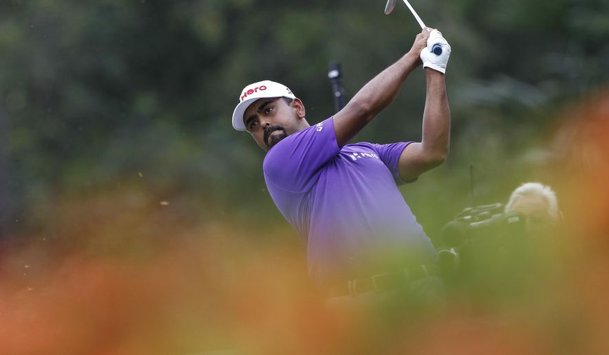Anirban Lahiri of India follows his shot on the eighth hole during the third round of the CIMB Classic golf tournament at Tournament Players Club  in Kuala Lumpur, Malaysia, Saturday, Oct. 22, 2016. (AP Photo/Joshua Paul)