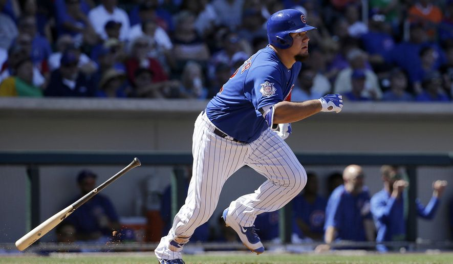FILE - In this March 26, 2016, file photo, Chicago Cubs' Kyle Schwarber leaves the batter's box during the team's spring training baseball game against the San Francisco Giants in Mesa, Ariz. Schwarber could return for the Cubs if they make it to the World Series. The Cubs had ruled Schwarber out for the year after he tore two ligaments in his left knee during an outfield collision in April. But a couple of positive medical reports led the team to activate the catcher/outfielder from the 60-day disabled list on Saturday so it could check him out in the Arizona Fall League. AP Photo/Jeff Chiu, File)