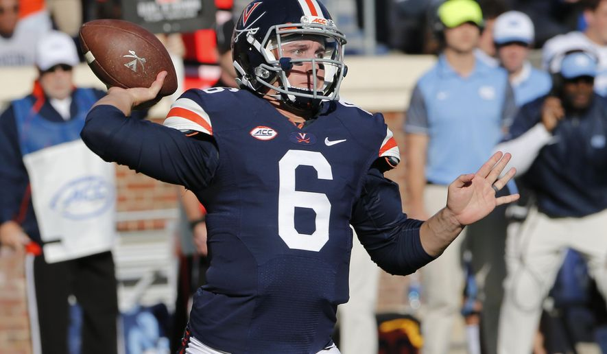 Virginia quarterback Kurt Benkert (6) throws a pass during the first half of an NCAA college football game between North Carolina and Virginia at Scott stadium in Charlottesville, Va., Saturday, Oct. 22, 2016. (AP Photo/Steve Helber)