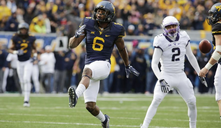 West Virginia wide receiver Daikiel Shorts (6) celebrates making a catch during the first half of an NCAA college football game against TCU, Saturday, Oct. 22, 2016, in Morgantown, W.Va. (AP Photo/Raymond Thompson)