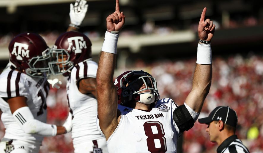 Texas A&M quarterback Trevor Knight (8) celebrates after wide receiver Josh Reynolds scored a touchdown during the first half of an NCAA college football game against Alabama, Saturday, Oct. 22, 2016, in Tuscaloosa, Ala. (AP Photo/Brynn Anderson)