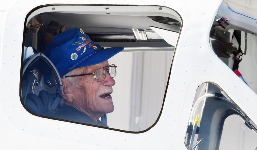 "ADVANCE FOR WEEKEND EDITIONS  OCT. 22-23 - In this Monday, Oct. 17, 2016 photo, seated in the co-pilot seat, World War II pilot Frank Royal, 101, gets ready to take off on his ""final flight"" in Colorado Springs, Colo. (Jerilee Bennett/The Gazette via AP)"