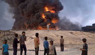 clouded: Islamic State fighters have ignited oil wells outside Mosul to create a smokescreen for U.S.-backed Iraqi and Kurdish forces. A successful liberation of Iraq's second-largest city would bolster President Obama's legacy of leading from behind. (Associated Press)