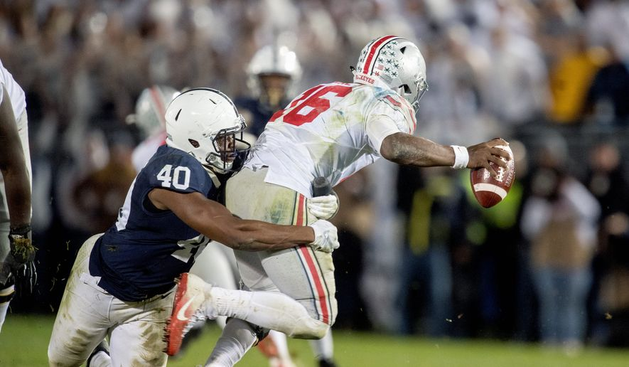 Ohio State quarterback J.T. Barrett was sacked six times in Saturday's loss to Penn State after the Buckeyes allowed just five in the first six games. (Associated Press)