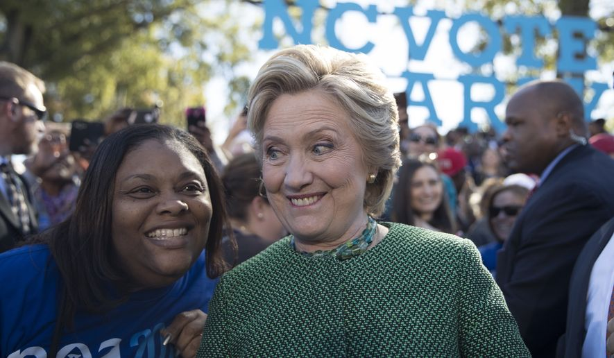 Democratic presidential candidate Hillary Clinton greets supporters during a campaign event at The Quad, Saint Augustine's University, Sunday, Oct. 23, 2016, in Raleigh, N.C. (AP Photo/Mary Altaffer)