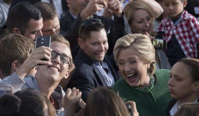Democratic presidential candidate Hillary Clinton greets supporters during a campaign event at University of North Carolina at Charlotte, Sunday, Oct. 23, 2016, in Charlotte, N.C. (AP Photo/Mary Altaffer)