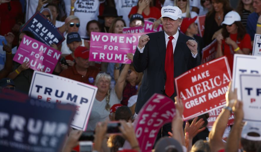 Republican presidential candidate Donald Trump pumps his fist during a campaign rally, Sunday, Oct. 23, 2016, in Naples, Fla. (AP Photo/ Evan Vucci)