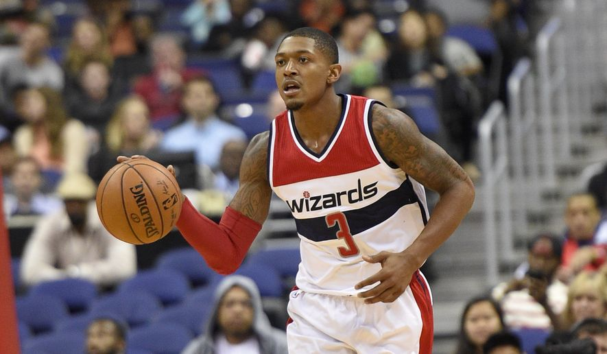 Washington Wizards guard Bradley Beal (3) dribbles the ball during the second half of an NBA preseason basketball game against the Toronto Raptors, Friday, Oct. 21, 2016, in Washington. The Wizards won 119-82. (AP Photo/Nick Wass) **FILE**