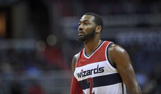 Washington Wizards guard John Wall (2) looks on during the first half of an NBA preseason basketball game against the Toronto Raptors, Friday, Oct. 21, 2016, in Washington. (AP Photo/Nick Wass)
