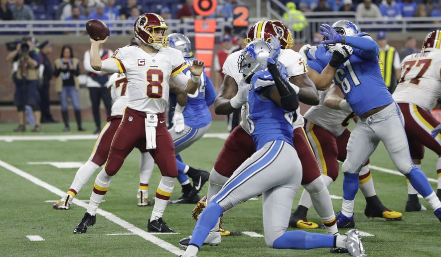 Washington Redskins quarterback Kirk Cousins throws during the first half of an NFL football game against the Detroit Lions, Sunday, Oct. 23, 2016 in Detroit. (AP Photo/Carlos Osorio)