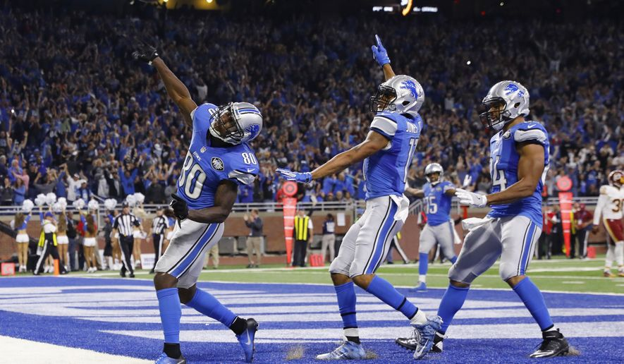 Detroit Lions wide receiver Anquan Boldin (80) throws the ball to fans after his 18-yard touchdown run with seconds remaining in the second half of an NFL football game against the Washington Redskins, Sunday, Oct. 23, 2016 in Detroit. (AP Photo/Rick Osentoski)