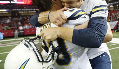 San Diego Chargers kicker Josh Lambo, right embraces San Diego Chargers defensive end Joey Bosa (99) after Lambo kicked the game winning field goal in overtime of an NFL football game, Sunday, Oct. 23, 2016, in Atlanta. The Chargers won 33-30. (AP Photo/John Bazemore)