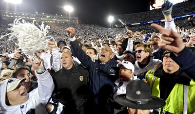 Penn State coach James Franklin, center, celebrates with the crowd after the team's 24-21 win over Ohio State during an NCAA college football game Saturday, Oct. 22, 2016, in State College, Pa. (Abby Drey/Centre Daily Times via AP)