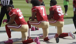 San Francisco 49ers safety Eric Reid (35), quarterback Colin Kaepernick (7) and outside linebacker Eli Harold (58) kneel during the national anthem before an NFL football game against the Tampa Bay Buccaneers in Santa Clara, Calif., Sunday, Oct. 23, 2016. (AP Photo/Marcio Jose Sanchez)