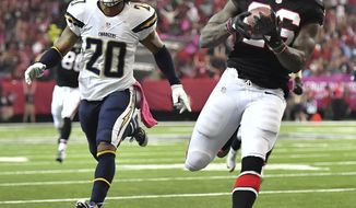 Atlanta Falcons running back Tevin Coleman (26) runs into the end zone for a touchdown against San Diego Chargers free safety Dwight Lowery (20) during the first half of an NFL football game between the Atlanta Falcons and the San Diego Chargers, Sunday, Oct. 23, 2016, in Atlanta. (AP Photo/Danny Karnik)