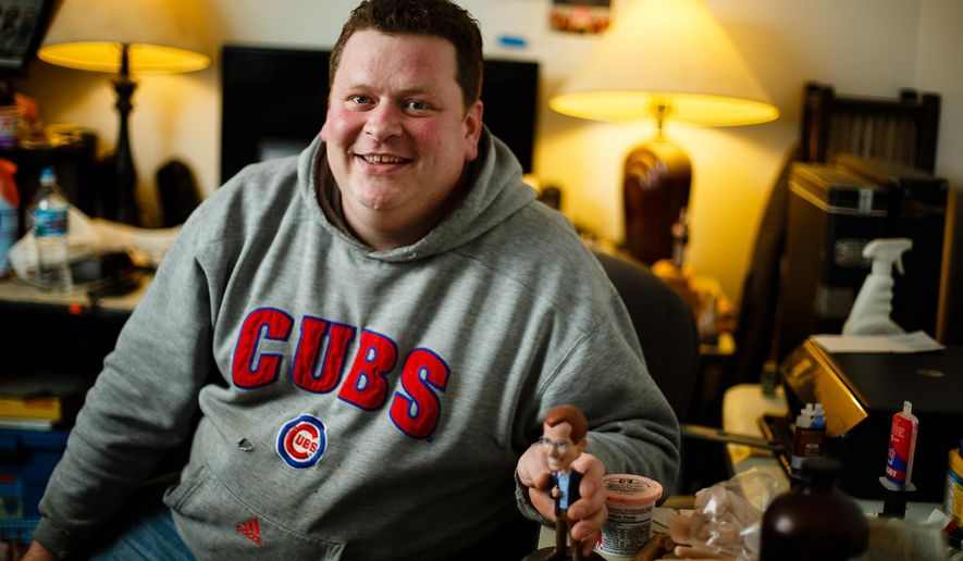 In this Thursday, Oct. 13, 2016 photo, bobblehead maker Bryan Guise poses in Des Moines. In the early 2000's Guise had a business making personalized bobbleheads that made it on numerous NBC television shows as well as many celebrities homes. The business became overwhelming for him and he walked away from it, leaving many orders unfilled. Now, he says he is healthier and ready to give it another shot and is starting by making bobbleheads out of his parents garage. (Brian Powers/The Des Moines Register via AP)