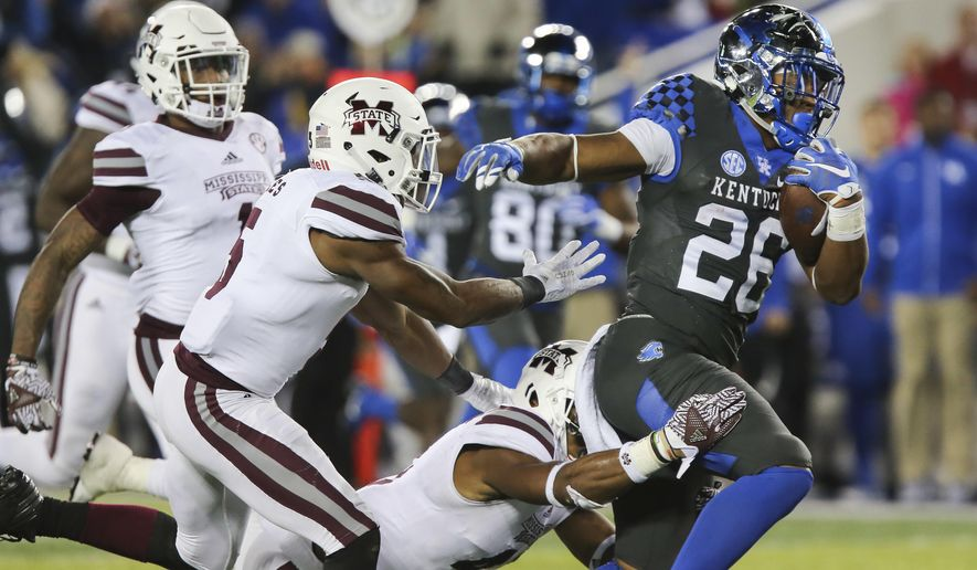 Kentucky running back Benjamin Snell Jr. runs past the Mississippi State defense on his way to score a touchdown during the second half of an NCAA college football game Saturday, Oct. 22, 2016, in Lexington, Ky. Kentucky won 40-38. (AP Photo/David Stephenson)