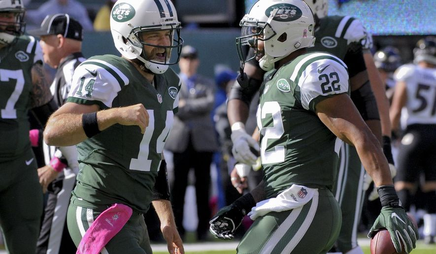 New York Jets quarterback Ryan Fitzpatrick (14) celebrates with running back Matt Forte (22) after Forte scored a touchdown against the Baltimore Ravens during the second quarter of an NFL football game, Sunday, Oct. 23, 2016, in East Rutherford, N.J. (AP Photo/Bill Kostroun)