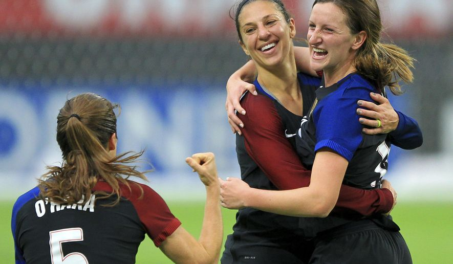 United States' Carli Lloyd, center, celebrates her goal with teammate Andi Sullivan, right, and Kelley O'Hara (5) against Switzerland in the first half during an international friendly soccer match Sunday, Oct. 23, 2016, in Minneapolis.(AP Photo/Andy Clayton-King)