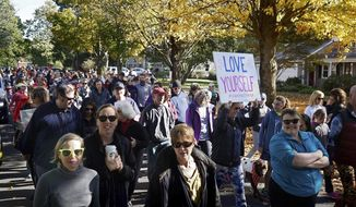 """People march for """"yoga pants parade"""" in Barrington, R.I., Sunday, Oct. 23, 2016. Hundreds of women, girls and other supporters proudly donned their yoga pants Sunday afternoon as they peacefully paraded around the Rhode Island neighborhood of a man who derided the attire as tacky and ridiculous. (Kris Craig/Providence Journal via AP)"""