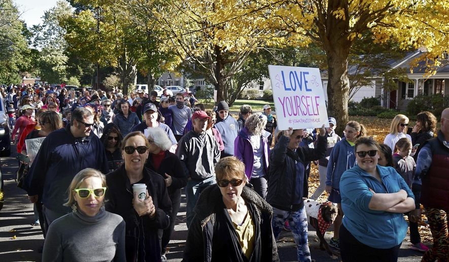 "People march for ""yoga pants parade"" in Barrington, R.I., Sunday, Oct. 23, 2016. Hundreds of women, girls and other supporters proudly donned their yoga pants Sunday afternoon as they peacefully paraded around the Rhode Island neighborhood of a man who derided the attire as tacky and ridiculous. (Kris Craig/Providence Journal via AP)"
