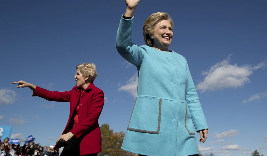 Democratic presidential candidate Hillary Clinton, right, accompanied by Sen. Elizabeth Warren, D-Mass., wave as they arrive at a rally at St. Anselm College in Manchester, N.H., Monday, Oct. 24, 2016. (AP Photo/Andrew Harnik)