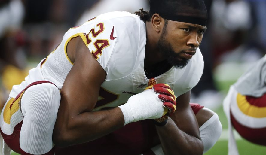 Washington Redskins cornerback Josh Norman stretches before an NFL football game against the Detroit Lions in Detroit, Monday, Oct. 24, 2016. Detroit won 20-17. (AP Photo/Paul Sancya)