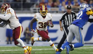 Washington Redskins running back Rob Kelley (32) runs against the Detroit Lions during an NFL football game in Detroit, Monday, Oct. 24, 2016. Detroit won 20-17. (AP Photo/Paul Sancya)