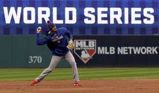 Chicago Cubs third baseman Kris Bryant warms up during a team practice for baseball's upcoming World Series against the Cleveland Indians on Monday, Oct. 24, 2016 in Cleveland. (AP Photo/David J. Phillip)
