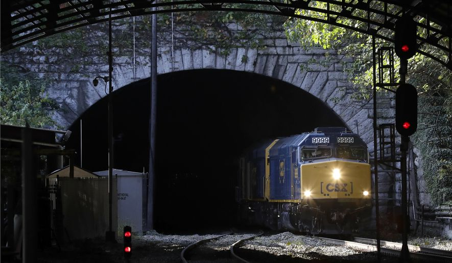 A CSX Transportation inspection train carrying Maryland Gov. Larry Hogan emerges from the Howard Street Tunnel in Baltimore, Monday, Oct. 24, 2016. Hogan announced that the state will reapply for federal funds to make room for double-stacked container trains in the aged tunnel on their way to the Port of Baltimore. (AP Photo/Patrick Semansky)