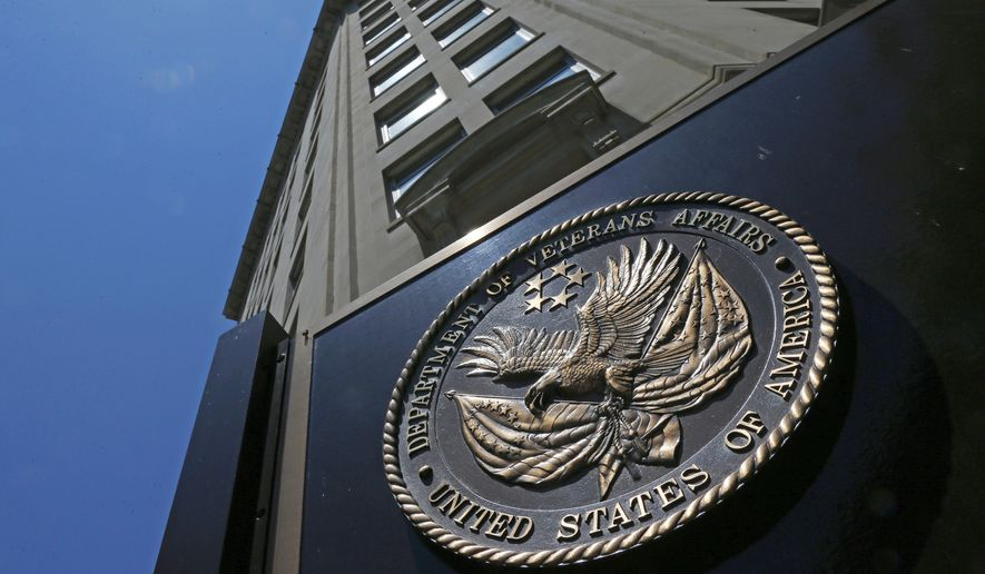 In this June 21, 2013, file photo, the seal a fixed to the front of the Department of Veterans Affairs building in Washington. On Jan. 10, 2017, the Office of Special Counsel confirmed a whistleblower's accusations that, on average, 1,100 patients wait more than 30 days for care at the VA's Phoenix hospital. (AP Photo/Charles Dharapak, File) **FILE**