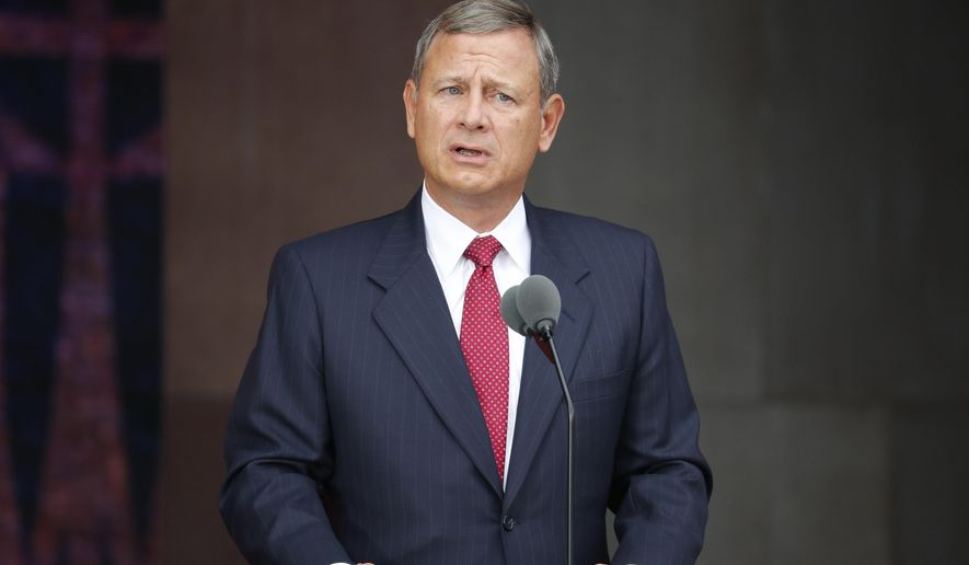 FILE - In this Sept. 24, 2016 file photo, U.S. Chief Justice John Roberts speaks at the dedication ceremony for the Smithsonian Museum of African American History and Culture on the National Mall in Washington. Roberts is upgrading his vacation home in Maine. Roberts and his wife, Jane Roberts, of Chevy Chase, Maryland, purchased a second Hupper Island home in the town of St. George in Oct. 2016. (AP Photo/Pablo Martinez Monsivais, File)