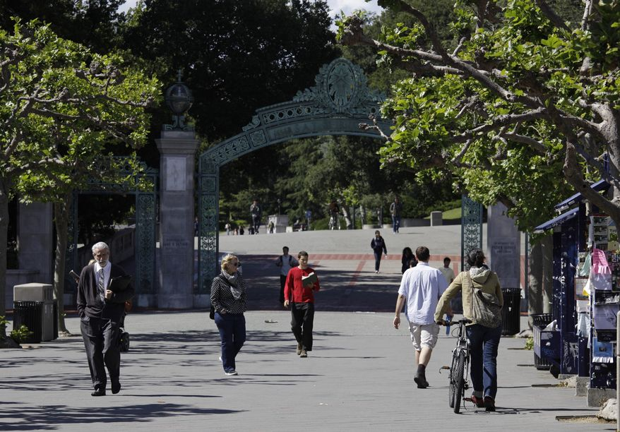 In this June 1, 2011, file photo, people walk through Sproul Plaza near the Sather Gate on the University of California, Berkeley campus in Berkeley, Calif. The university suspended a class on Sept. 13, 2016, amid complaints that it shared anti-Semitic viewpoints and was designed to indoctrinate students against Israel. (AP Photo/Eric Risberg, File)