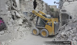 In this photo taken Sept. 26, 2016 and provided by the local council of Aleppo city, Syrians workers clean damaged after airstrikes, in Aleppo, Syria. The opposition-held districts of the Syrian city have been surrounded and under siege for months. Russian and Syrian warplanes are bombing the streets into rubble and government forces are chipping away at the pocket of opposition control. (Local Council of Aleppo City via AP)