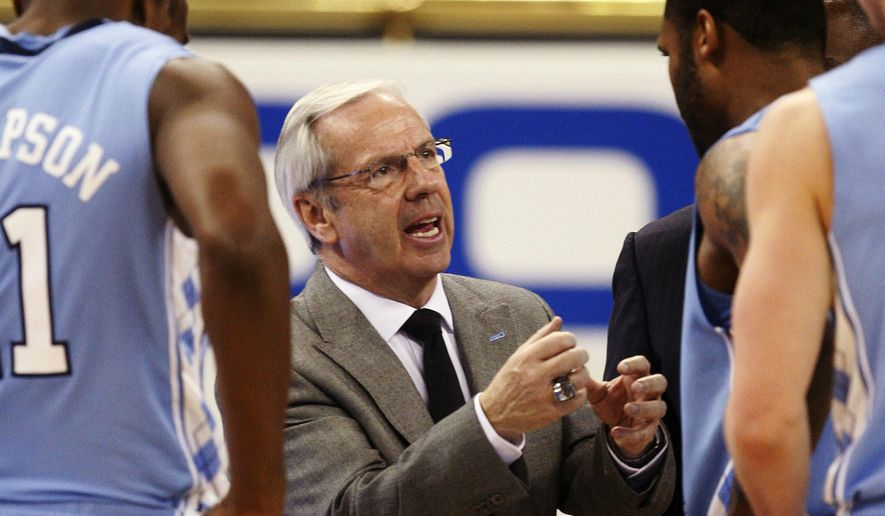 FILE - In this Feb. 16, 2010, file photo, North Carolina head coach Roy Williams talks to his players in the second half of an NCAA college basketball game against Georgia Tech in Atlanta. The Hall of Fame coach is leading a veteran team with three returning starters from a team that won the ACC regular-season and tournament titles before losing to Villanova in the NCAA championship game. (AP Photo/John Bazemore, File)