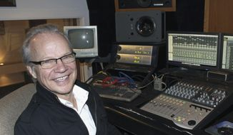 In this Dec. 18, 2013, file photo, Bobby Vee poses at the studio console at his family's Rockhouse Productions in St. Joseph, Minn. Vee, whose rise toward stardom began as a 15-year-old fill-in for Buddy Holly after Holly was killed in a plane crash, died Monday Oct. 24, 2016 of complications from Alzheimer's disease. He was 73. (AP Photo/Jeff Baenen, File)