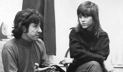 In this Dec. 26, 1972, file photo, actress Jane Fonda, right, and Tom Hayden, one of the founders of SDS, talk at the home of a friend in London, after their arrival from Paris. Hayden, the famed 1960s anti-war activist who moved beyond his notoriety as a Chicago 8 defendant to become a California legislator, author and lecturer, has died at age 76. His wife, Barbara Williams, says Hayden died on Sunday, Oct. 23, 2016, in Santa Monica of a long illness. (AP Photo, File)